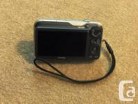 Pocket sized digital camera with 14X optical zoom,