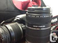 SLR Canon Rebel XSi - amazing camera, comes with the