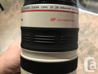 EF 28-300 f/3.5-5.6L IS USM with case and comes with