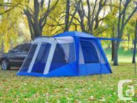 The Sportz SUV Tent Model 84000 wraps around the cargo