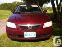 Make Mazda Year 2002 Trans Automatic kms 210000 Body