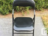 Set of 4 black cushioned card table chairs. Not