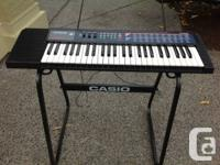 Casio keyboard with stand and music stand, has rarely