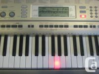 Casio digital keyboard with 61 touch sensitive, lighted