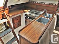 The Catalina 30 is a popular cruising sailboat that