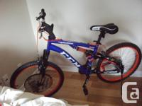 CCM Savage Youth Dual Suspension Mountain Bike with an