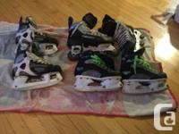 2 pairs of skates and a pair of roller blades. The CCM