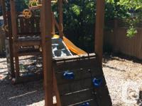 Large cedar play set with fort, swings, monkey bar