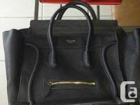 """The """"Mini Luggage"""" tote is the signature style from"""