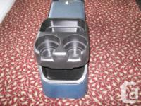 4 cup holders with lockable compartment , coin tray and