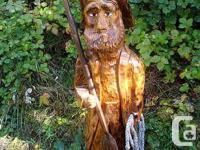 I created this aged guy out of a red cedar log as well