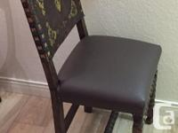 The chair is in good sturdy condition . Leather back