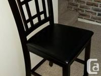 2 Counter height chairs. Purchased from The Brick in