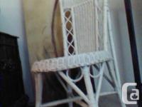 One is white with a round seat and tall back. Two are