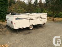 Lightweight, hard shell fold up trailer. My 11 year old