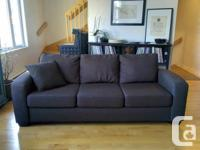 - Charcoal grey 3 seat textile couch with wood legs. -