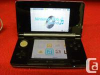 Charcoal Nintendo 3DS console with charger, model