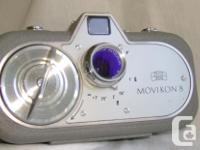 Cult Camera from the 60's with leather case and roll of