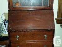In great condition, a cherry wood secretary bureau with
