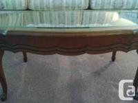 Lovely beveled glass cherry wood coffee table and