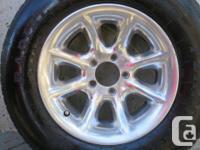 "4 - Chevrolet 15"" x 7"" mag rims & tires with caps."