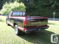 Make Chevrolet Year 1990 Colour red/ black two tone