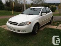 Make Chevrolet Model Optra Year 2006 Colour White kms