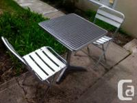 Selling a patio/bistro table and two chairs.  This set