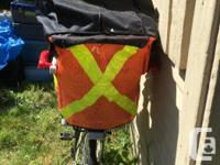 Rear mounted child carrier for a bicycle. Comes with