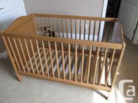 Solid Pine infant crib. 2 mattress elevation levels.