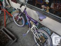 Bicycle for a child, roughly 7-12 years of age. The