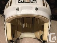 White CCM child's Helmet for sale. Pending size of f