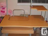 Steel of a deal: Light brown childs desk Immaculate