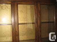 A 1975 Victoriaville built China cabinet from a smoke