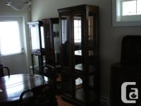 This China/Curio Cabinet is 30 inches wide 15 inches