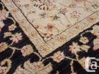 Two Ziegler chintz rugs with black border (as shown) for sale  British Columbia