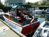This is a beautifully restored 1955 Chris Craft 22'