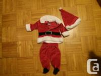 Christmas Dress and Santa Suit 0-3 months $10 each.