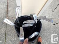 Citation right handed golf clubs with Mizuno bag. Irons