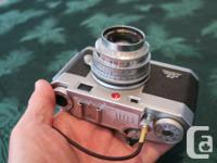 A classic 35mm film camera, rangefinder design similar