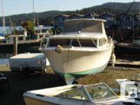 This is a classic 1968 Fiberglass Chris Craft Sedan