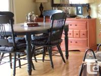Solid country look oak table with six chairs (2 captain
