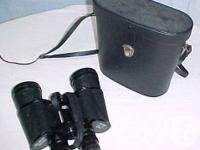 For sale is a pair of Vintage Carl Hoffer Binoculars