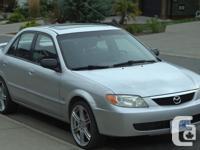 Make Mazda Model Protege Colour silver Trans Manual