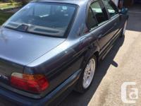 Make BMW Model 740i Year 2000 Colour Titanium Trans