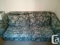 A tidy and comfortable  couch bed in great disorder for