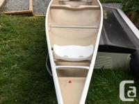 Clipper Ranger 16 foot fibreglass canoe. Summer is