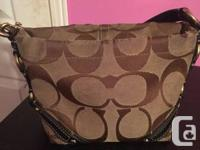 I'm selling my small Coach purse.   It's camel coloured