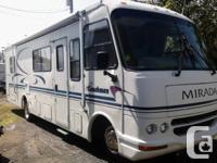 A great shape and low miles 2000 Coachman class a