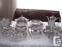 It is beautiful china set, delicate porcelain, hand